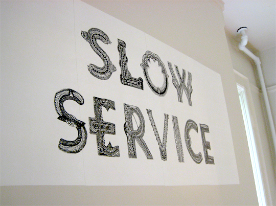 slow-food-cafe-slow-service-sign